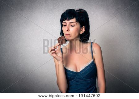 Pretty woman close up eating the chocolate