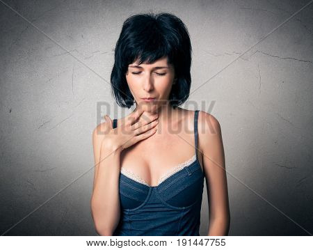 Woman close up has a throat pain