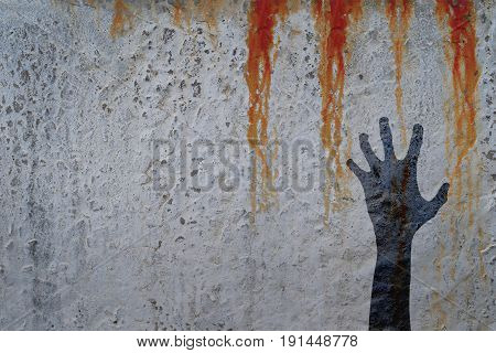 Zombie hand silhouette in shadow on concrete wall and blood background with copy space for text or image. Zombie theeme with corpse hands on cemetery. Halloween theme.
