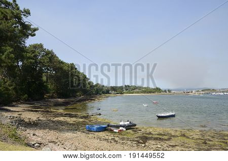 LA TOJA, SPAIN - AUGUST 8, 2016: Some boats in cove of the Island of La Toja in the province of Pontevedra Galicia Spain.