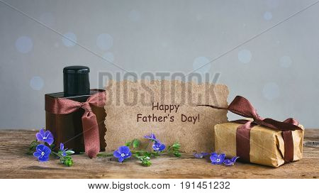 Fathers day card gift box with brown ribbon perfume bottle paper tag with words