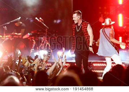 WANTAGH, NY-JUN 15: Tyler Hubbard (L) and Brian Kelley of Florida Georgia Line perform in concert at Northwell Health at Jones Beach Theater on June 15, 2017 in Wantagh, New York.
