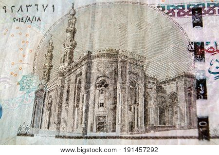 Detail of the Al-Rifai Mosque in Cairo on the back of an Egyptian ten pound note. Used banknote photographed at an angle.