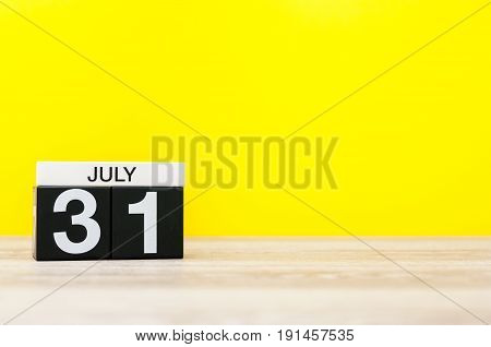 July 31th. Image of july 31, calendar on yellow background. Summer time. With empty space for text.