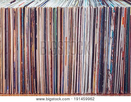 Old vinyl records, collection of albums, vintage process. Music background.