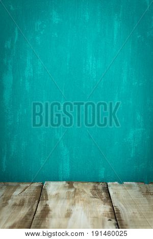 Wooden table top with green wall background