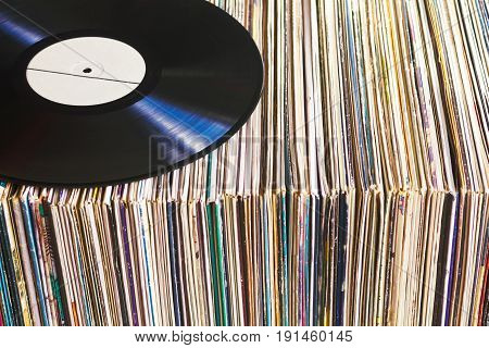 Vinyl record with copy space on collection of albums, vintage process