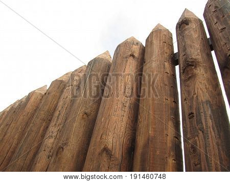 Fence from the stockade, logs of brown color