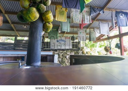 Avatele, Niue, May 28, 2017; Famous Washaway Cafe bar with food and drinks price board on back wall built on side of bay open air with corrugated iron roof decorated with old stuff at Avatele Bay Niue