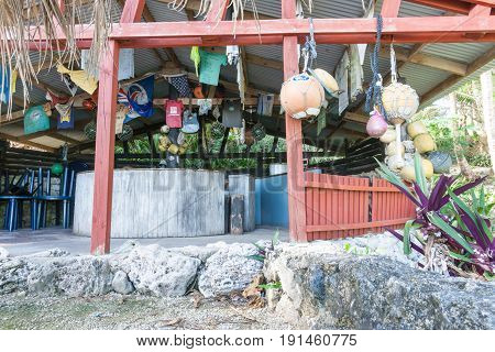 Avatele, Niue, May 28, 2017; Famous Washaway Cafe built on side of bay open air with corrugated iron roof decorated with old stuff at Avatele Bay Niue