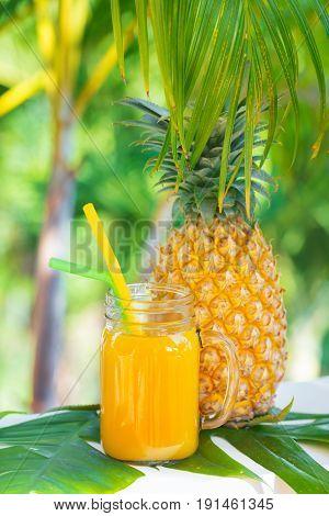 Fresh yellow pineapple tropic fruit summer refreshment smoothie shake drink outdoors