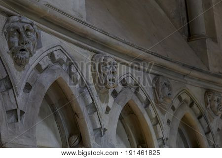 LONDON, GREAT BRITAIN - SEPTEMBER 19, 2014: These are grotesque portraits of human faces on the inner walls of the Temple Church.