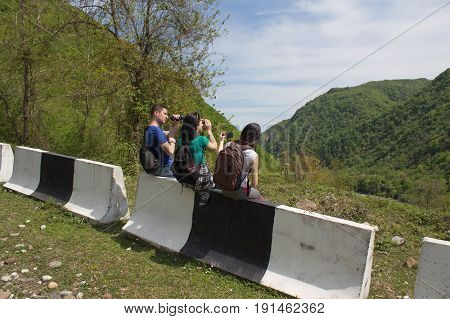 Active and healthy lifestyle on summer vacation and weekend tour. Active hikers. Tourists hitching a ride