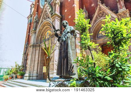ISTANBUL TURKEY - MAY 4 2017: Monument to St. Antuan near St. Anthony of Padua Church alternatively known as the Sant Antonio di Padova Church in Istanbul Turkey