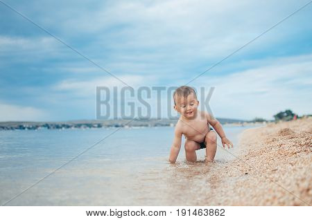 A Child Sitting In The Sea