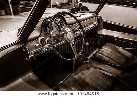 STUTTGART GERMANY - MARCH 02 2017: Cabin of the Mercedes-Benz 300 SL (W198). Stylization. Sepia toning. Europe's greatest classic car exhibition