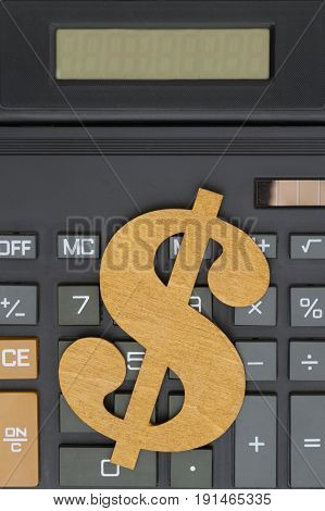 Close-up of a calculator with a dollar sign and large display