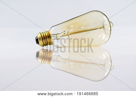 Old tungsten bulb on white isolated background