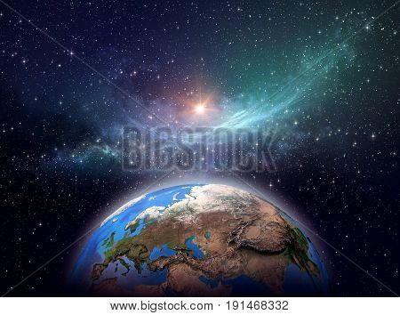 Planet Earth, star cluster and nebula in outer space, bright light shining far behind - Elements of this image furnished by NASA