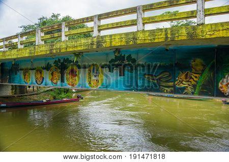 CUYABENO, ECUADOR - NOVEMBER 16, 2016: Bridge over the Cuyabeno River with a boat below it, Cuyabeno National Park in Ecuador.