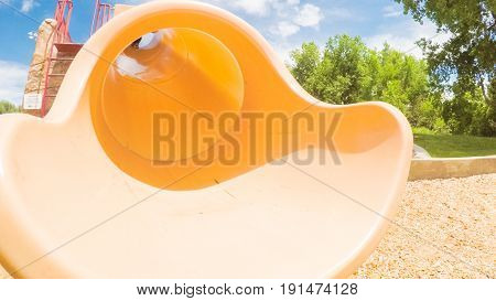 Little girl playing on the kids playground in the Summer.