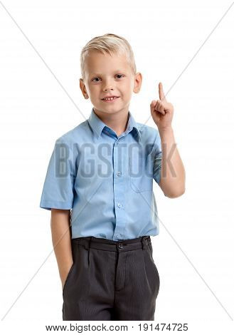 Portrait of little genious boy with raised finger having an idea
