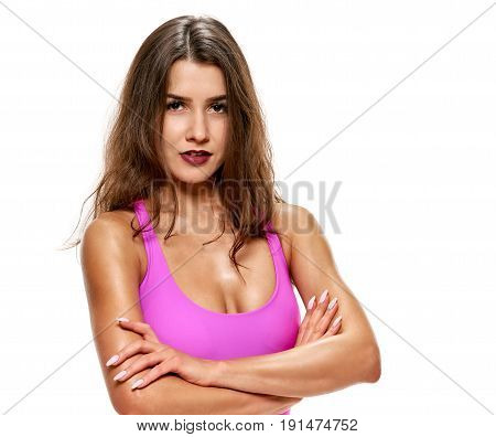 Portrait of beautiful young sporty woman posing on white background