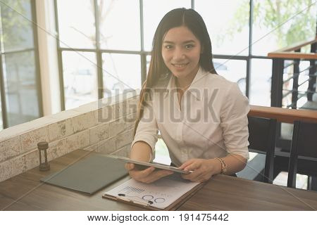 Businesswoman Use Tablet To Analyze Market Chart At Workplace. Young Female Entrepreneur Woman Worki