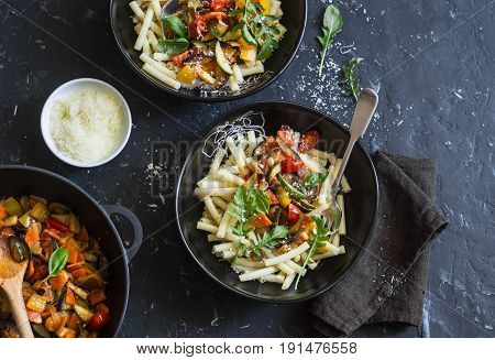 Quick ratatouille pasta. Delicious vegetarian healthy food concept. On a dark background top view