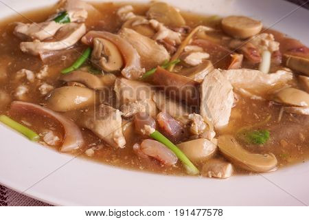 mushroom , pork and dried squid fried with oyster sauce