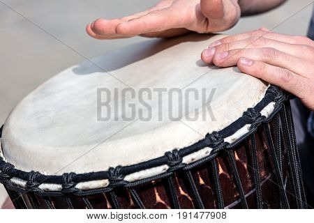 Street Talented Musician Playing African Drum Djembe Outdoors