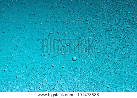 Teal water drops abstract background wet texture