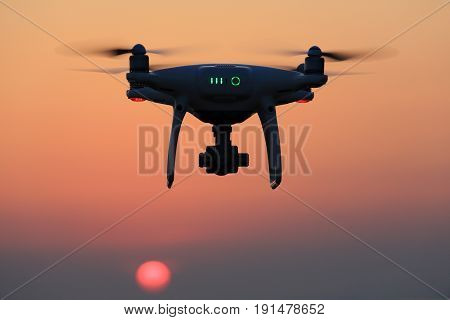 KAGAWA, JAPAN - JUNE 15, 2017: Remote controlled drone Dji Phantom 4 Pro equipped with high resolution video camera flying in air and sunset sky.