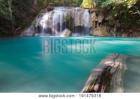 Blue stream water fall in tropical deep forest natural landscape background
