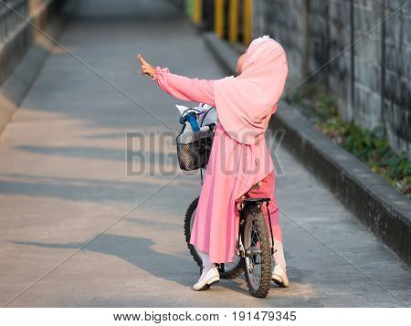 happy muslim girl with full hijab in pink dress asian traditonal style dress