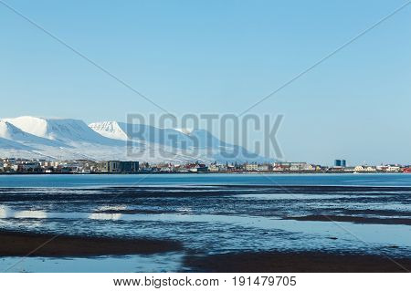 Iceland small city with mountain during winter season natural landscape background