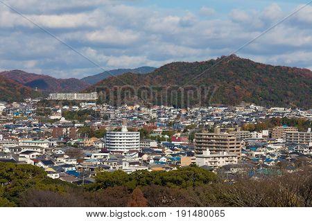 Osaka city residence area covered mountain during autumn season Japan