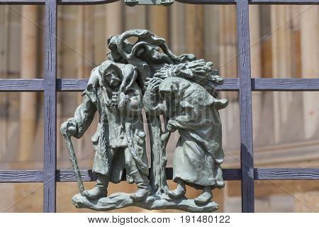 14th century St. Vitus Cathedral details of Golden Gate fence small figures Prague Czech Republic. It is a Roman Catholic metropolitan cathedral in Prague the seat of the Archbishop of Prague.