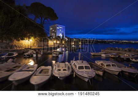 Fishing Boats In Small Mediterranean Port At Dusk