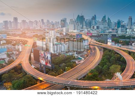 Aerial view Bangkok city highway and downtown at twilight cityscape downtown background
