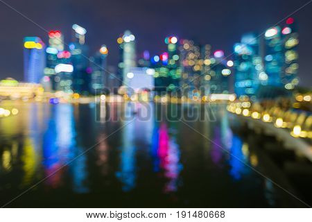 Blurred bokeh ligth Singapore city central business downtown abstract background water front