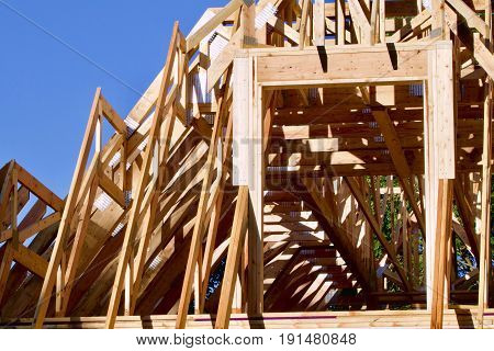 Pine skeleton of a new house under construction