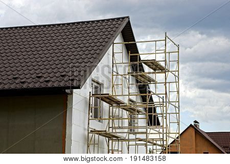 Repair of a private house with a brown tiled roof