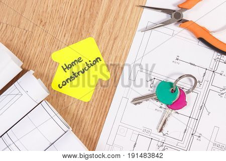 Home Keys, Metal Pliers, Electrical Drawings And House Shape With Text Home Conctruction, Building H