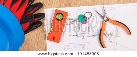 Home Keys With Electrical Drawings, Protective Blue Helmet With Gloves And Orange Work Tools, Concep