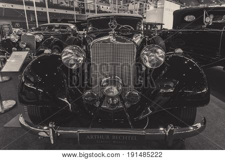 STUTTGART GERMANY - MARCH 02 2017: Luxury car Mercedes-Benz Typ 320 Cabriolet D (W142) 1939. Stylization. Black and white. Europe's greatest classic car exhibition