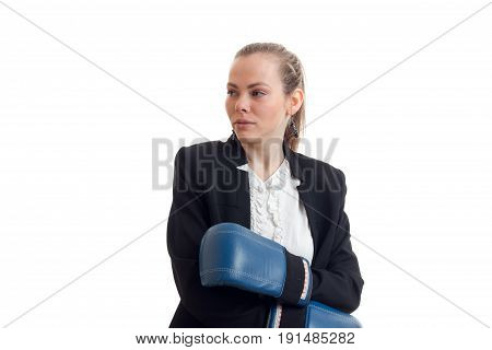 Portrait of sexual young girl in a black jacket and boxing gloves is isolated on a white background