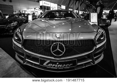 STUTTGART GERMANY - MARCH 02 2017: Sports car Mercedes-Benz SL350 (R231) 2012. Black and white. Europe's greatest classic car exhibition