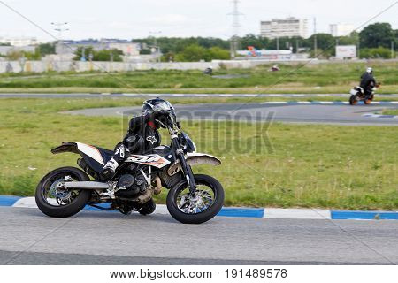 A Motorcycle Racer Takes A Practice Run On A Sports Track