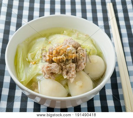 Thai Cuisine and Food Bowl of Traditional Chinese Cabbage with Minced Pork and Fish Meat Ball Soup Topping with Fried Garlic.